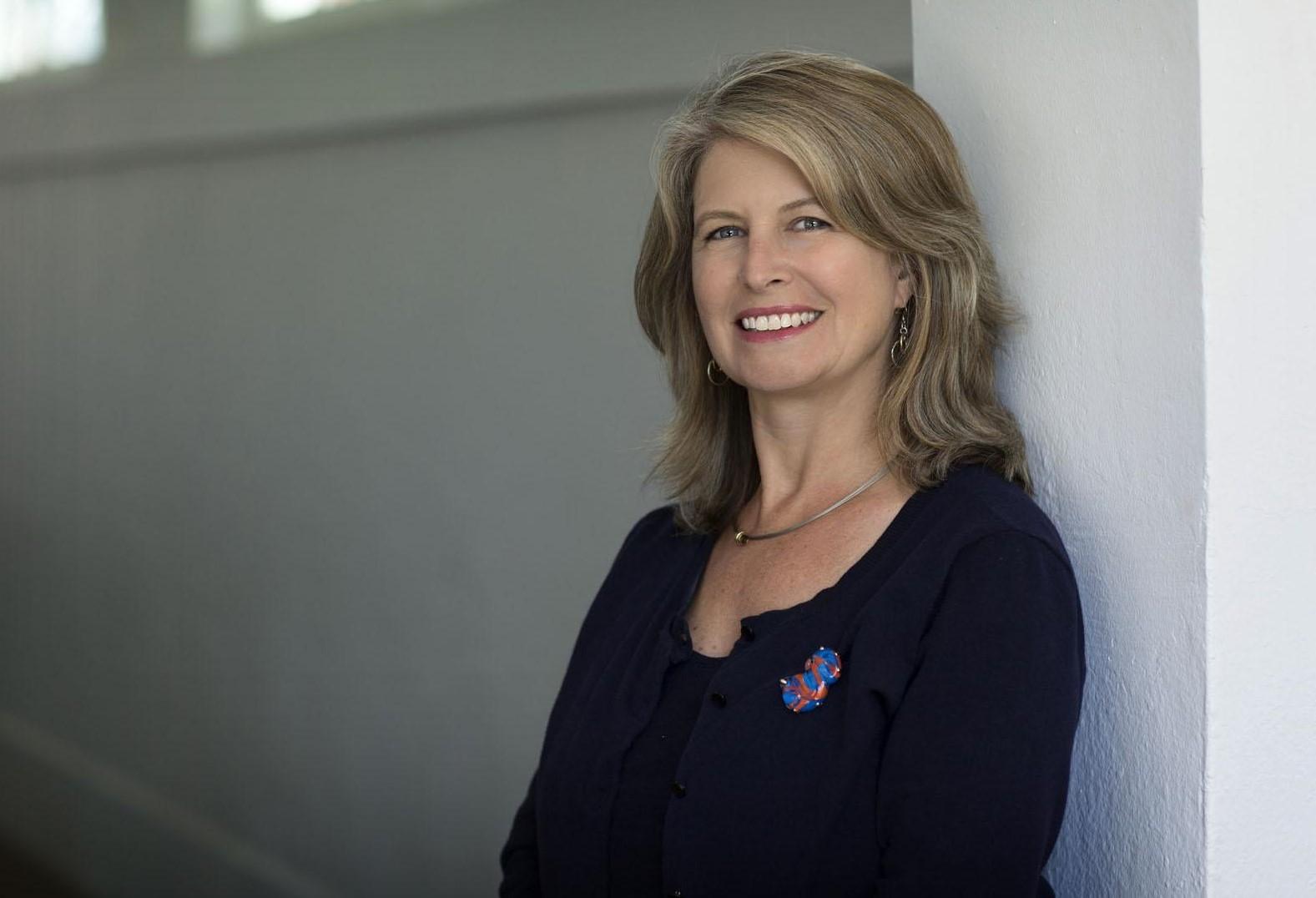 A female UVA staff member smiling